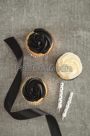 cup cakes with black and cream
