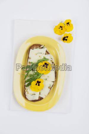 slice of bread garnished with pecorino