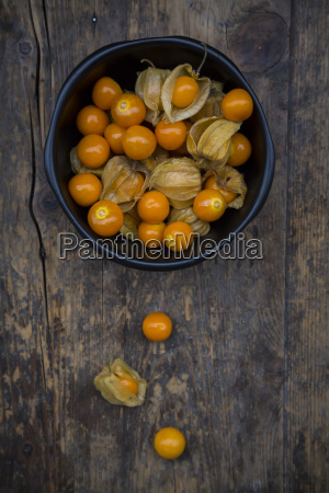 physalis in bowl and on wood