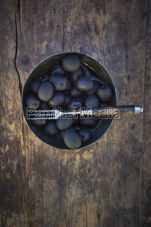 bowl of black olives and fork
