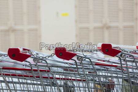 row of shopping carts close up