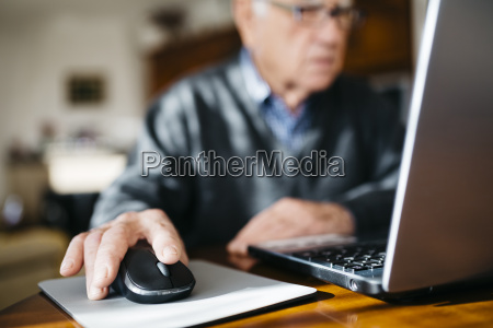 hand of senior man using mouse