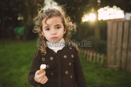 portrait of little girl with ice