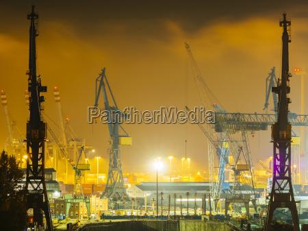 germany hamburg harbour cranes at port