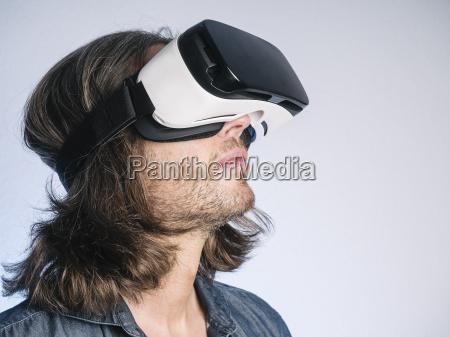man wearing virtual reality glasses looking