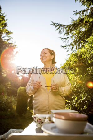 smiling mature woman in garden