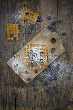 waffles with icing sugar and blueberries
