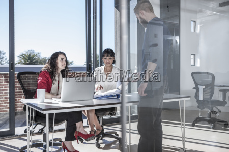 young professionals working together in office