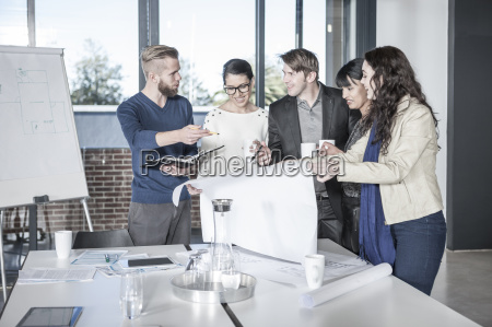 group of young professionals having meeting