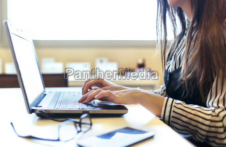 businesswoman at her desk working with
