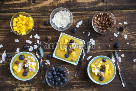 bowls of mango smoothie with diced