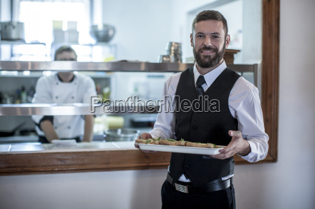 waiter picking up food from the