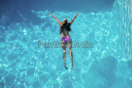 woman swimming in swimming pool