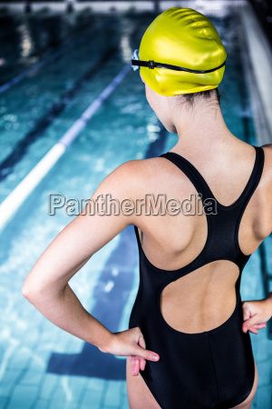 swimmer woman stretching at edge of