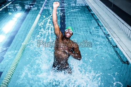 fit man diving in the swimming