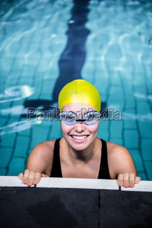 swimmer woman lean on the edge