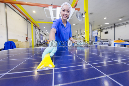 technician worker smiling at camera cleaning