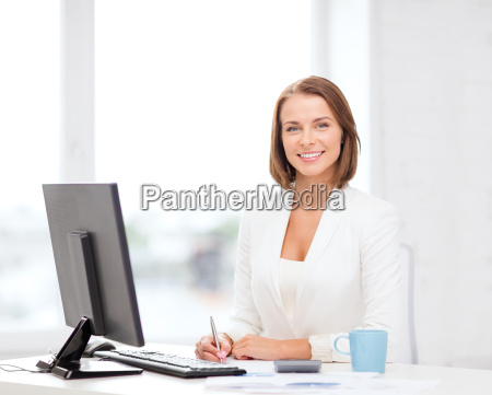 businesswoman with computer documents and coffee