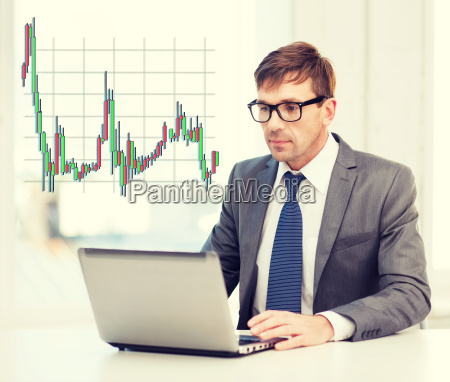 businessman with laptop computer and forex