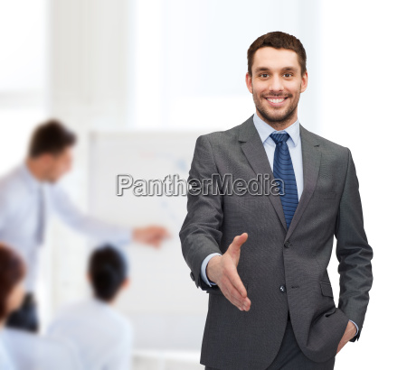 businessman with open hand ready for