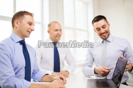 smiling businessmen having discussion in office