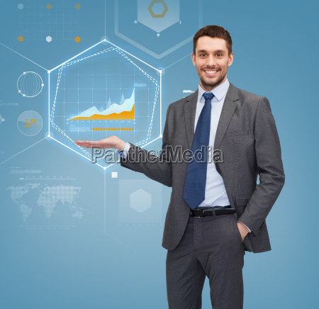 businessman showing graph on virtual screen