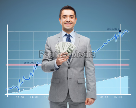 smiling businessman with dollar money