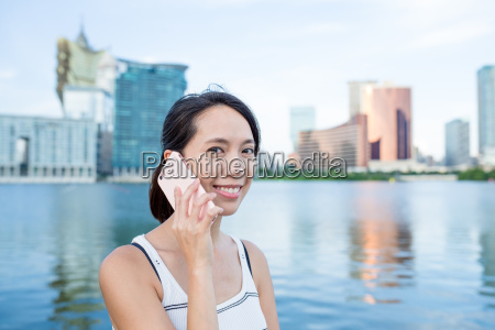 woman talking to cellphone in macao