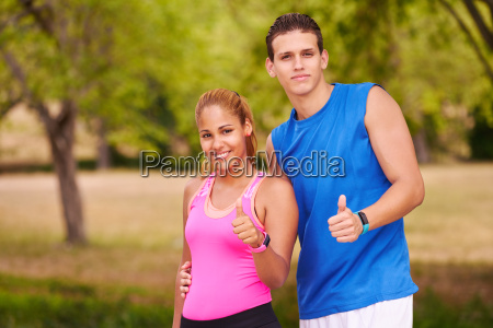 portrait young couple with thumb up