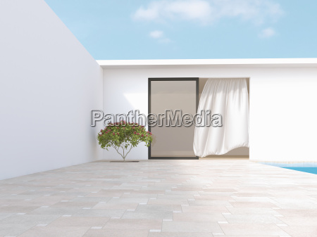 bright courtyard with red frangipani and