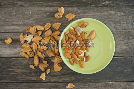 almonds green plate on wood