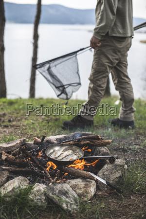 bulgaria man frying rudd at camp