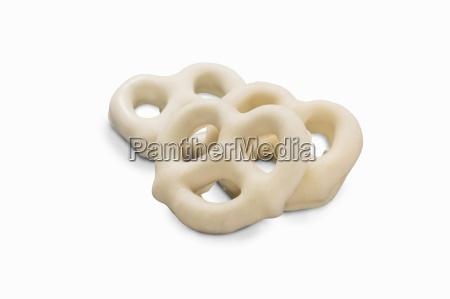 three mini white chocolate pretzels close