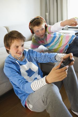 teenage boys playing video game together
