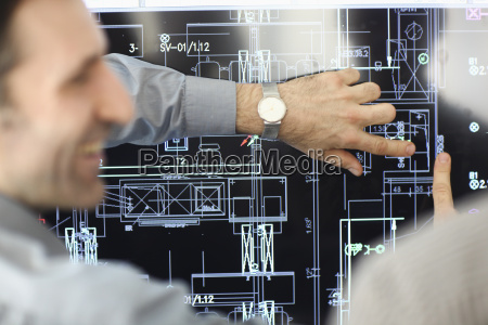architect showing plans to colleague