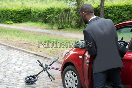 young african male driver looking at