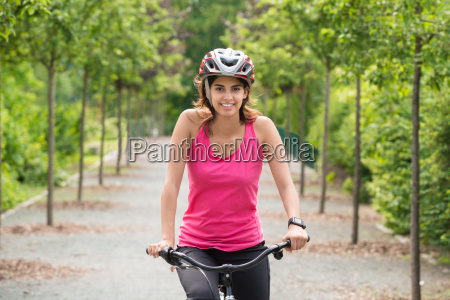female cyclist riding on bicycle