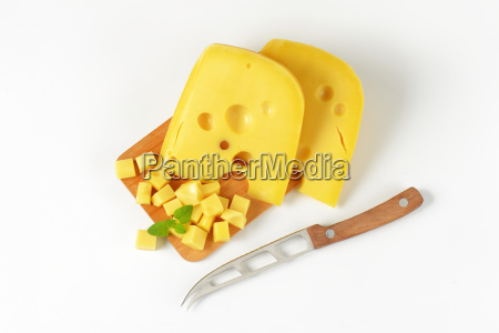 wedges and cubes of swiss cheese