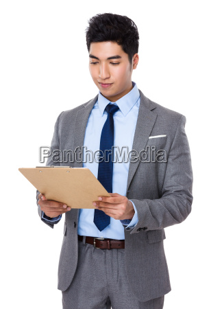 asian businessman read the report on
