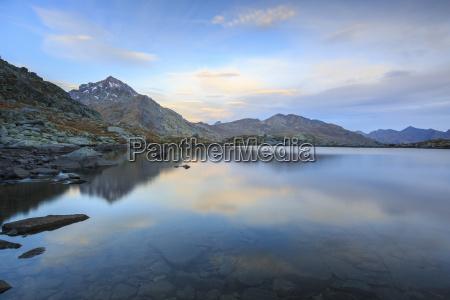 peak tambo reflected in lake bergsee