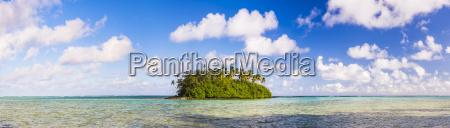 tropical island of motu taakoka covered