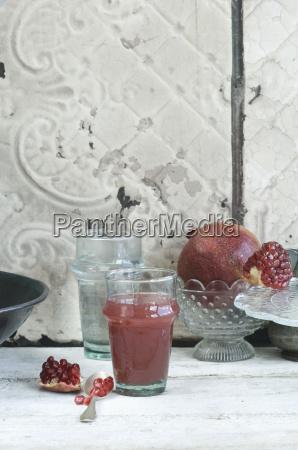 glass of pomegranate juice and pomegranate
