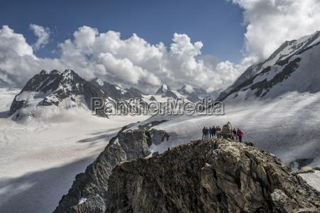 switzerland arolla mountaineers standing at summit