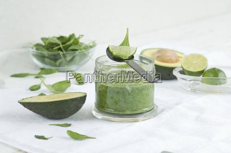 glass of spinach avocado lime smoothie