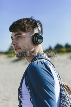 young man with wireless headphones on