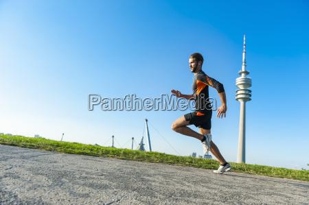 man running fast on path