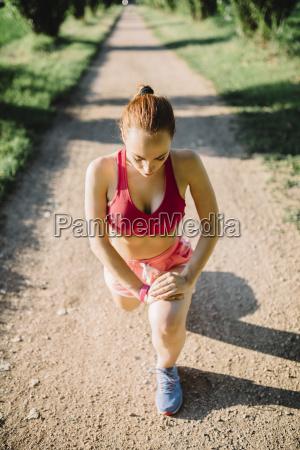 italy tuscany sportswoman stretching