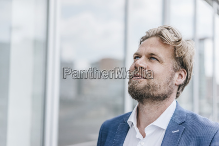 confident businessman looking up
