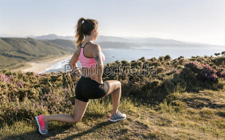 spain asturias sportswoman on the coast