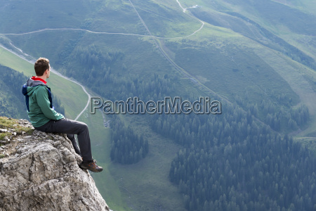 austria tyrol hiker sitting on rock